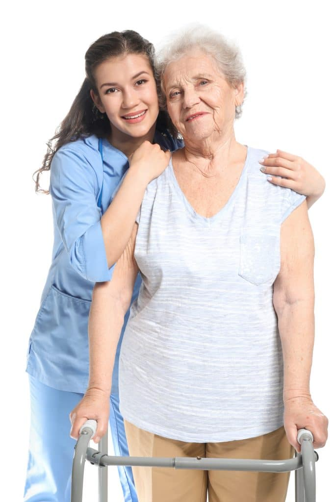 Young caregiver with senior woman on white background